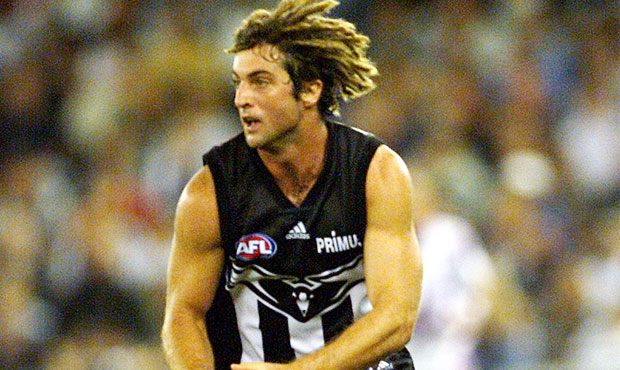 Shane O'Bree showcases Collingwood's pre-season jumper circa 2001-2004 in the third round of the 2001 Ansett Cup against North Melbourne at Colonial Stadium.
