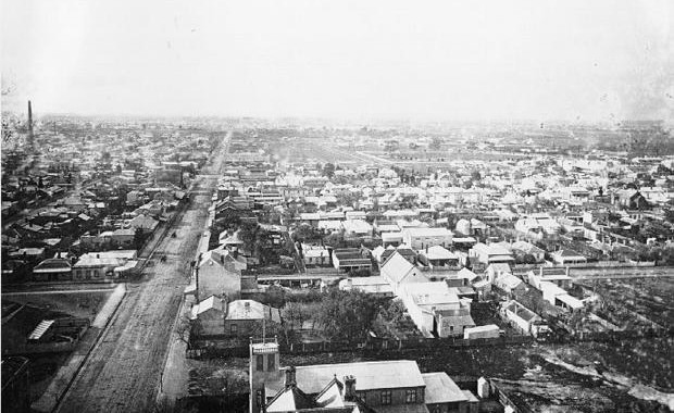 An overhead view of the suburb of Collingwood with Victoria Park in the distance (1880s).