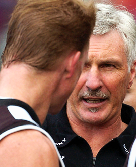 Nathan Buckley talks with his coach Mick Malthouse during the round two match between Collingwood and the Western Bulldogs at the MCG in 2004.