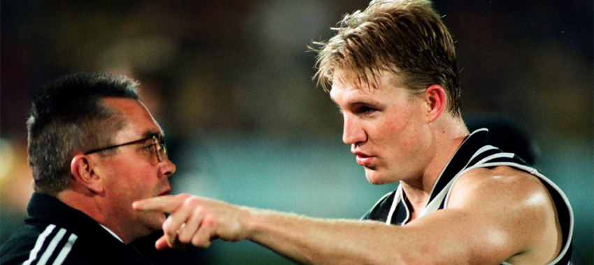 Captain Nathan Buckley speaks to coach Tony Shaw during the round 16 contest against Hawthorn at Waverley Park in 1998.