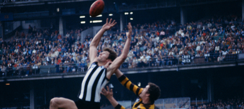 Phil Carman flies for a mark against Hawthorn in the 1970s.