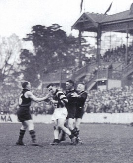 The incident that led to Gordon Coventry's suspension, as Richmond players come in to remonstrate (Reference The Official Collingwood Illustrated Encyclopedia by Michael Roberts and Glenn McFarlane).