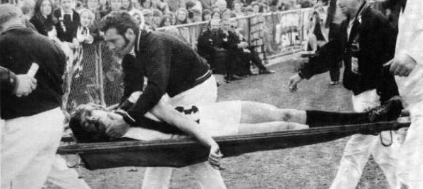 John Greening is stretchered from the ground after the incident.