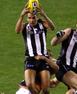 Andrew Krakouer flies for a mark in the round nine match against Adelaide in 2011.