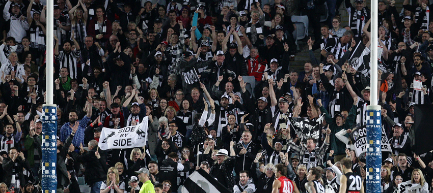 Collingwood supporters celebrate a goal in the round 20 contest against Sydney in 2013.