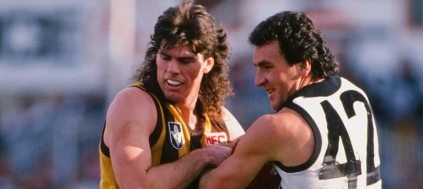 Gary Ayres of the Hawks clashes with Darren Millane of the Magpies during the 1988 VFL match.
