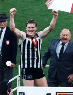 Nathan Buckley celebrates winning the Jack Oatey Medal.