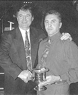 Tony Shaw accepts the Most Courageous award from board member Wayne Richardson in 1994.