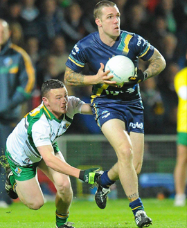 Dane Swan of Australia in action against Leighton Glynn of Ireland during the Irish Daily Mail International Rules Series 1st Test between Ireland and Australia at the Gaelic Grounds, Limerick in 2010.