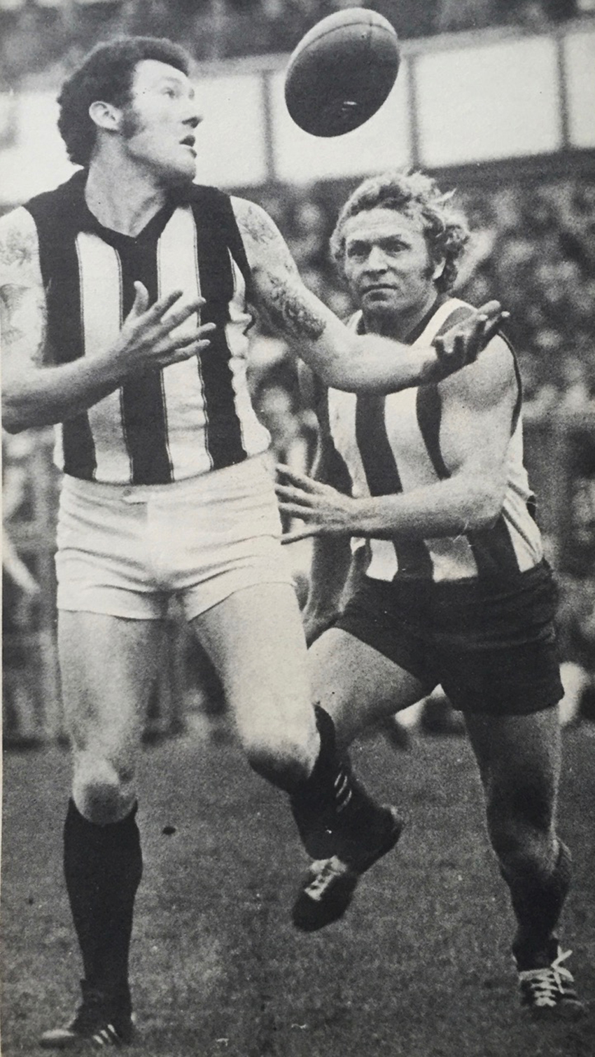 Grose paddles the ball ahead of North Melbourne's Barry Cable.
