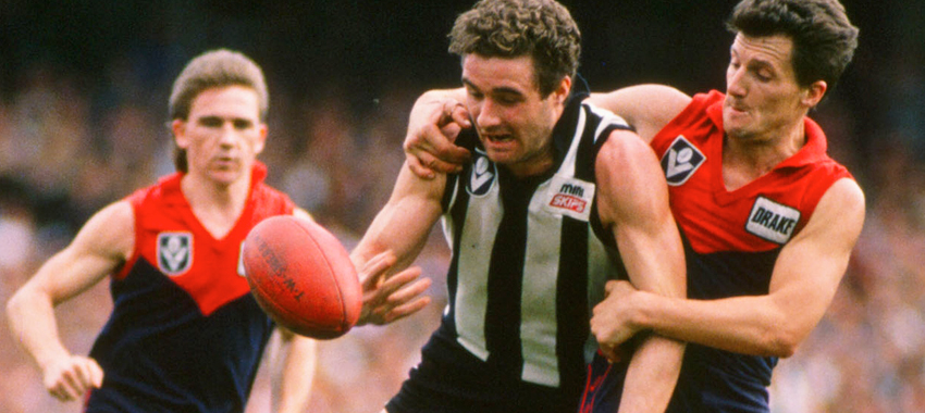 James Manson at his aggressive best against Melbourne during the late 1980s.
