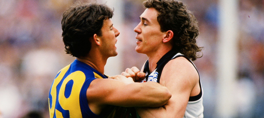 Mick Gayfer comes to grips with Eagle Brett Heady during the Qualifying Final Replay of 1990.