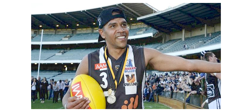Future Magpie Andrew Krakouer models a Swan Districts jumper after the 2011 WAFL Grand Final.
